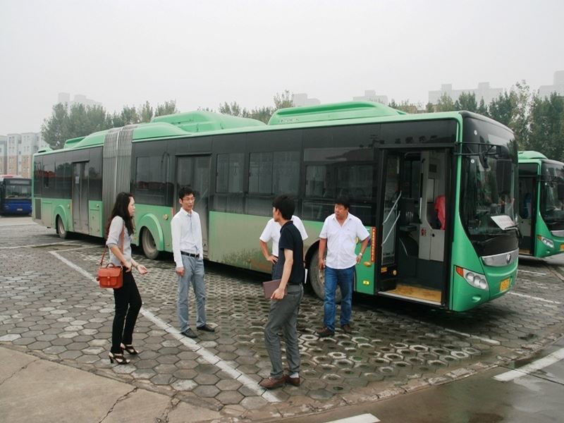 a group of passengers in front of an ecoBus