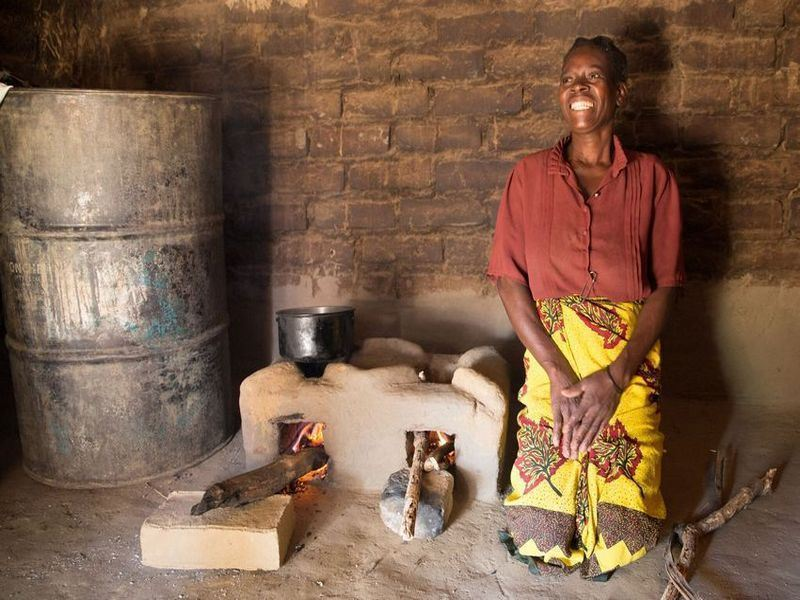 a woman cooking with the cook Stove